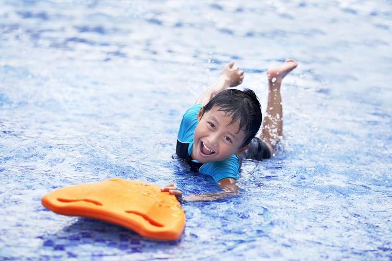 Boy having fun at swimming pool