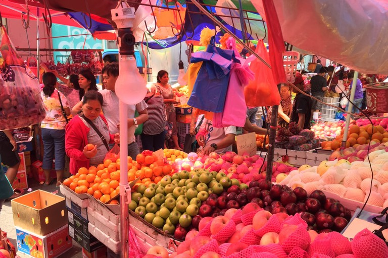 Imported apples, pears, and oranges are sold by vendors in Manila, Philippines