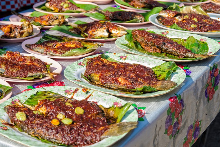 Grilled fish with spicy sauce on plate selling in Ramadan Bazaar Kuala Lumpur