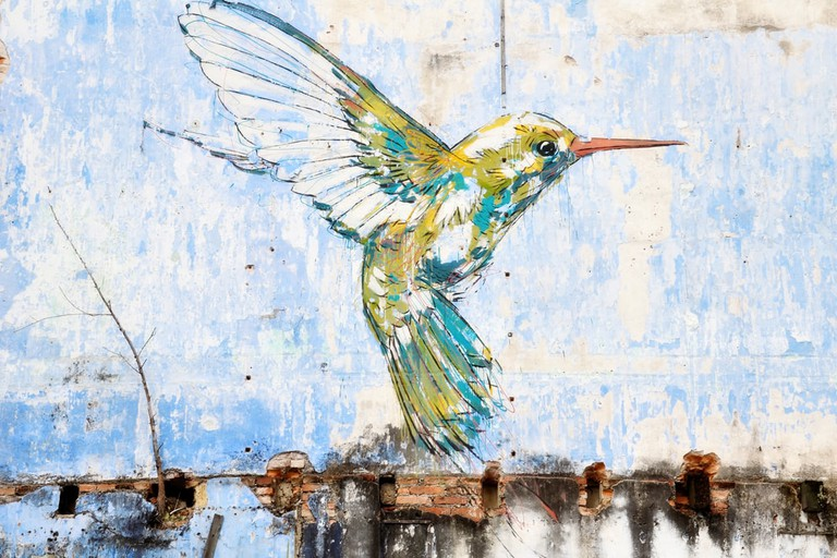 """Hummingbird"" wall art painted by famous artist, Ernest Zacharevic in Ipoh, Malaysia"