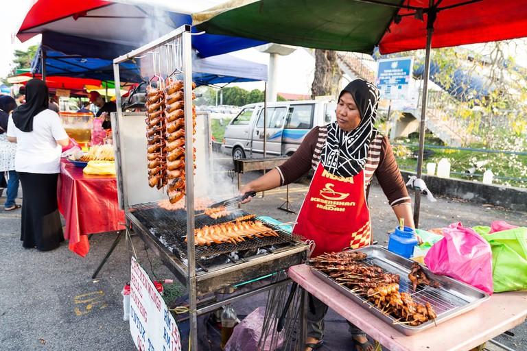 Vendors selling cuisine at street bazaar, Kuala Lumpur, Malaysia