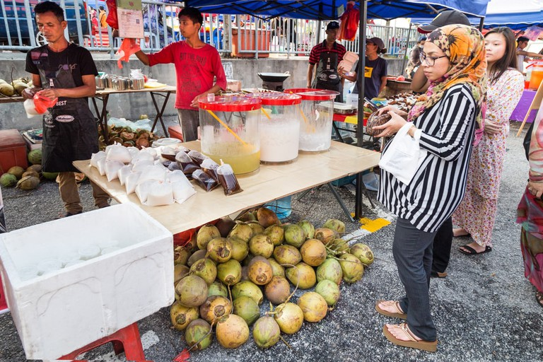 FIrst day of Ramadan with food vendors at street bazaar selling delicacies catered for iftar or buka puasa