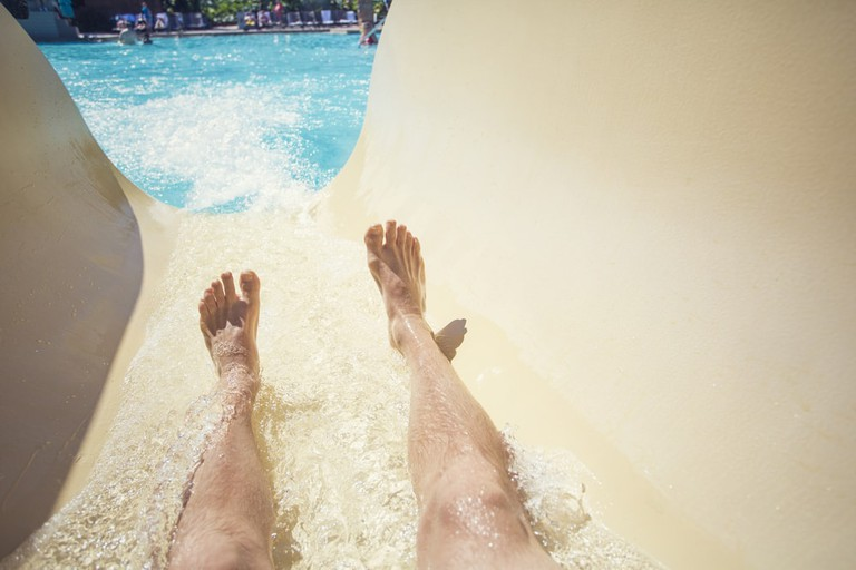 Riding down a slide at a waterpark