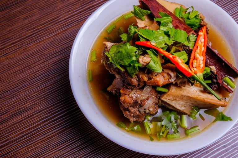 Cow bone soup or Sup Tulang in Malay with chili and soy sauce