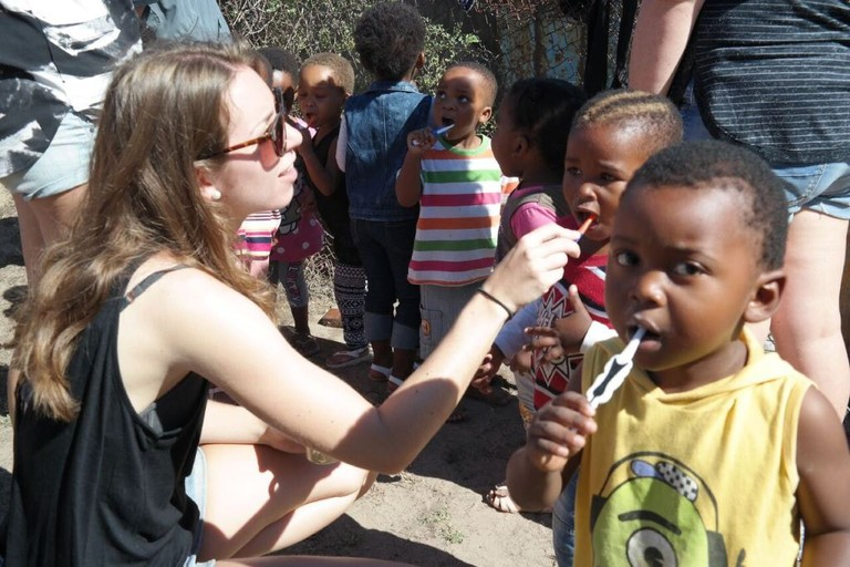 Teaching children oral hygiene at Izizwe Township