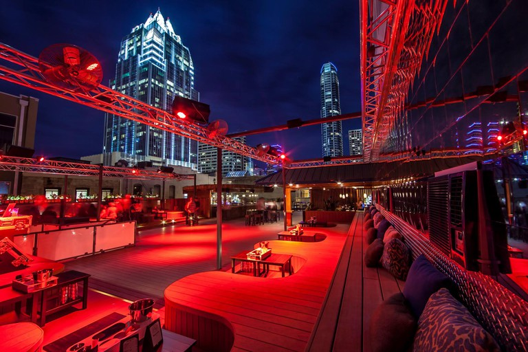 The Summit Rooftop Lounge's dance floor sits just under Austin's skyline
