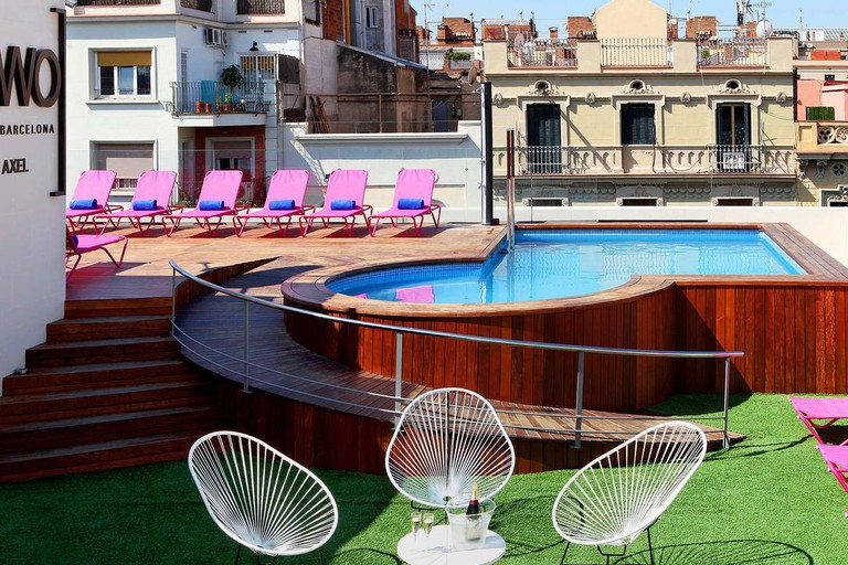 TWO Hotel Barcelona's swimming pool is kitted out with hot-pink lounge chairs