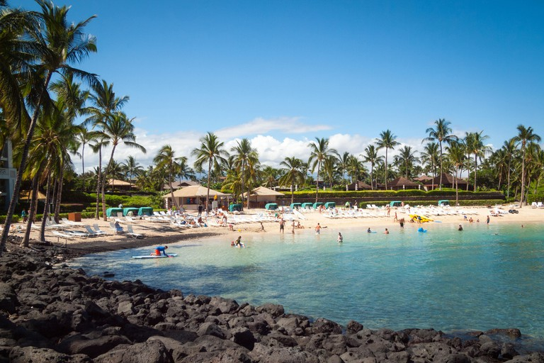 A view of Pauoa Bay and the beach on the property of the Fairmont Orchid, a luxury hotel and resort on the Kohala Coast, Hawaii.