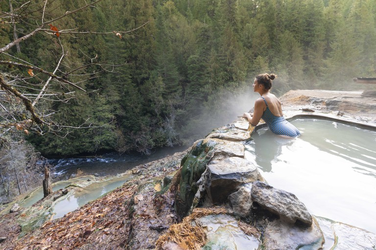 Woman relaxing at Umpqua Hot Springs, Douglas county, Oregon, United States.