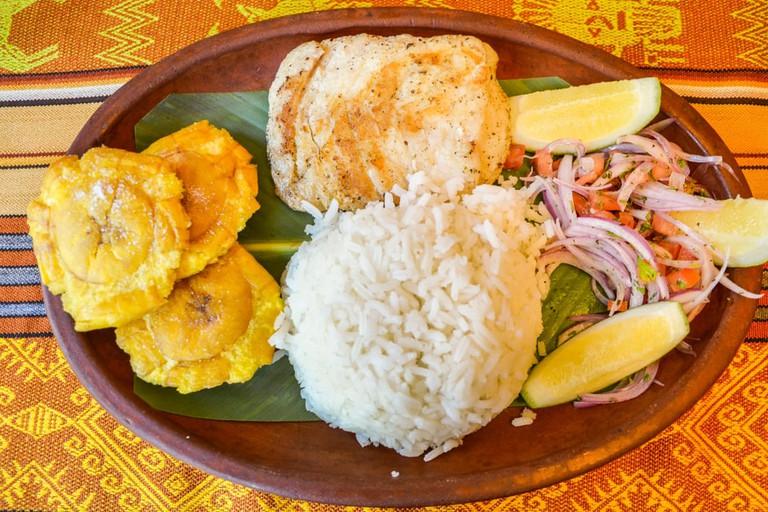 Llapingachos, fried potato cakes that originated in Ecuador
