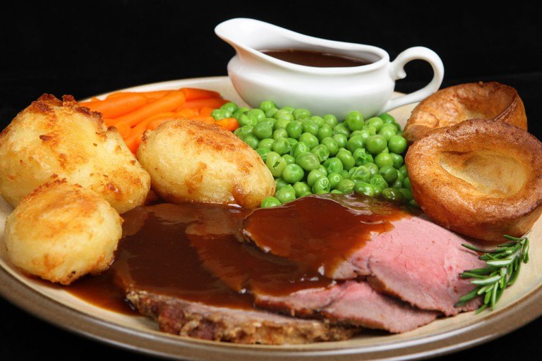 British roast beef dinner with Yorkshire puddings