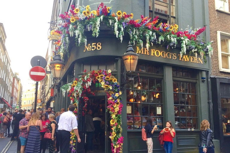 Patrons drink up outside the colourful entrance of Mr Fogg's.