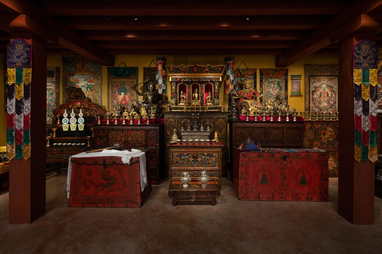 Installation view of The Tibetan Buddhist Shrine Room at the Rubin Museum with ritual objects.