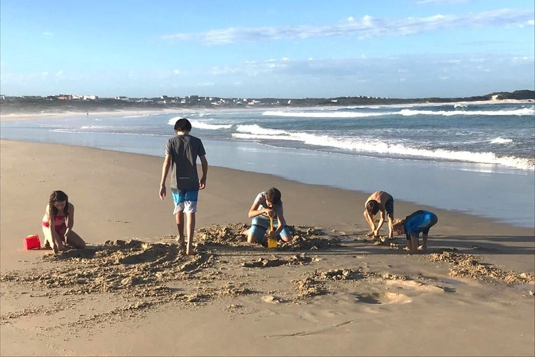 Kids playing in the sand at Seal Point beach