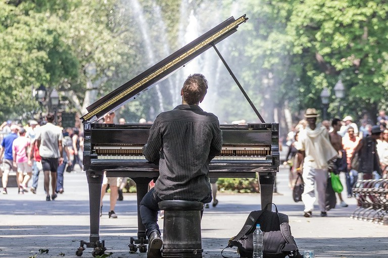 A piano player at Washington Square Park