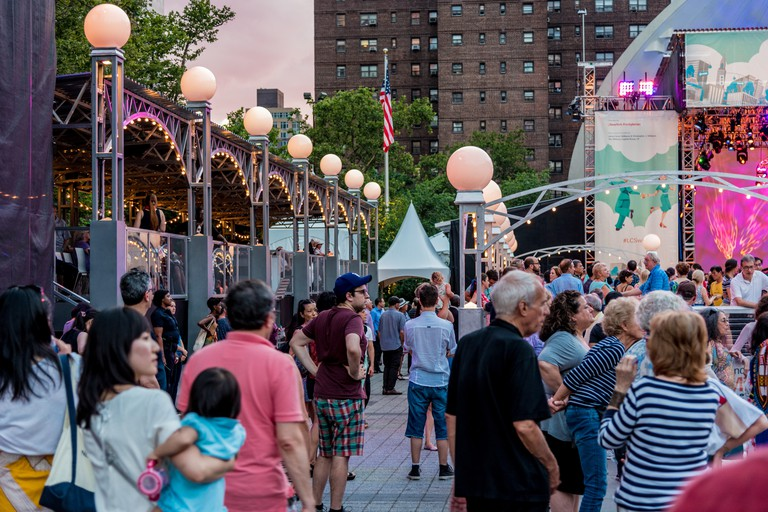 Revelers at Midsummer Night Swing can dance to live salsa, honky-tonk and big-band music