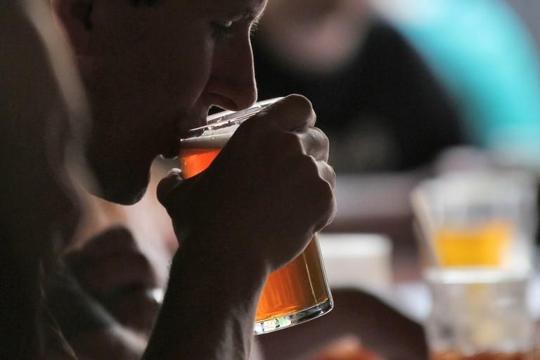 A man enjoying a beer