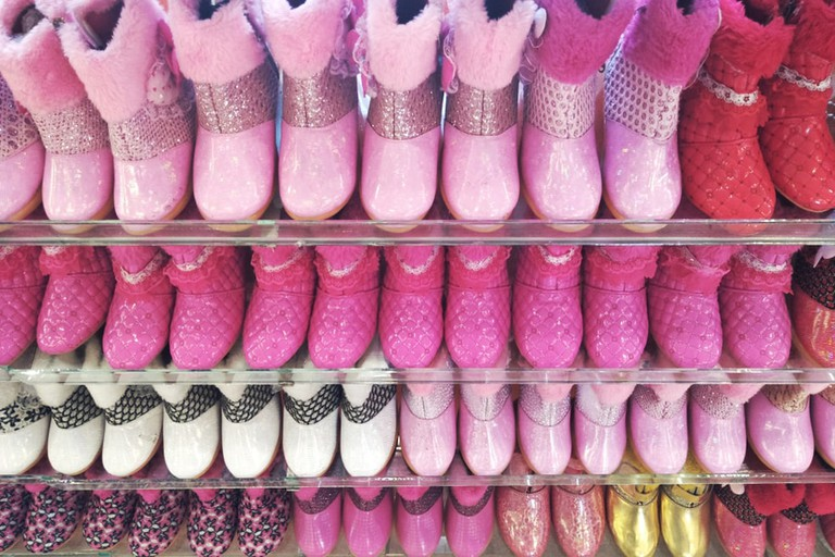 Variety of pink shoes display on supermarket shelf, Bandung, Indonesia