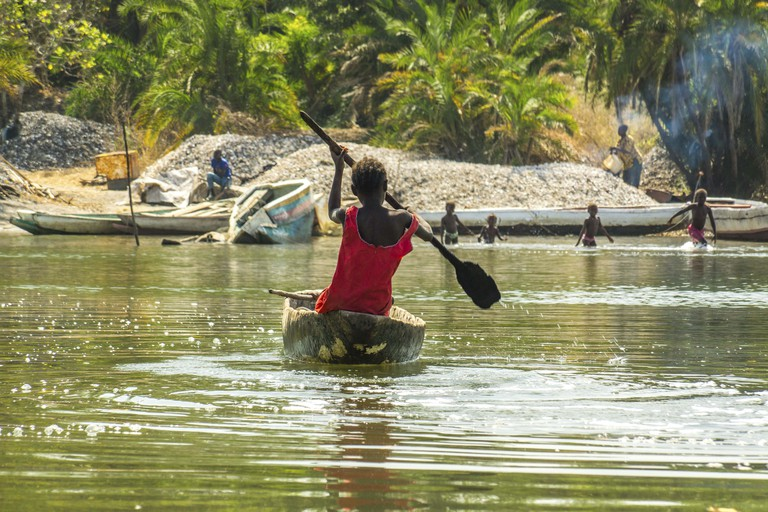 Children practice canoeing in the River Gambia near Makasutu forest in Gambia, West Africa.