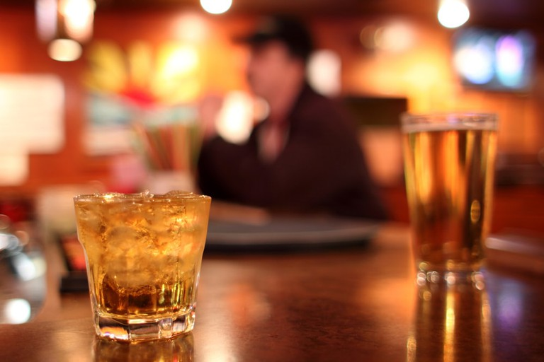 Whiskey and beer are available at Irish pubs in Woodside, Queens