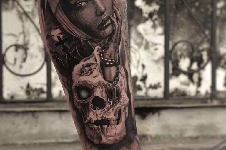 A portrait tattoo by Boe Toee
