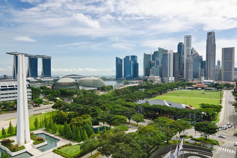 Singapore City skyline overlooking the Padang, Marina Bay and Downtown Core Central Business District.