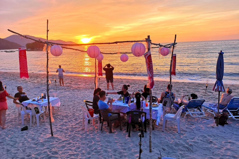 Customers enjoying the view of the sunset from Frandy Beach Bar