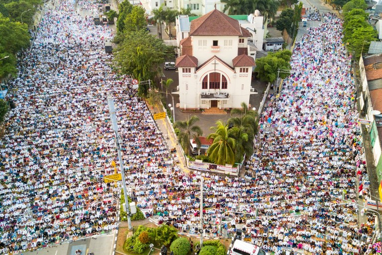 Thousands of people praying together on the street during Eid-ul Fitr day near Koinonia Church in East Jakarta, Indonesia.