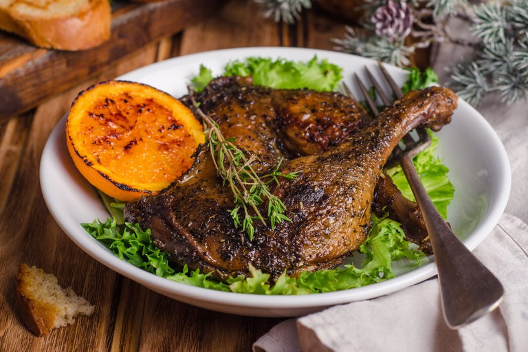 Confit duck legs with thyme and a slice of orange