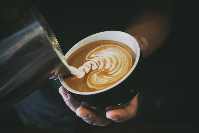 Barista making a latte