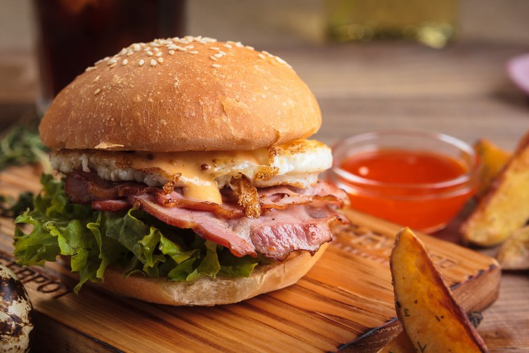 Breakfast burger with ham and eggs