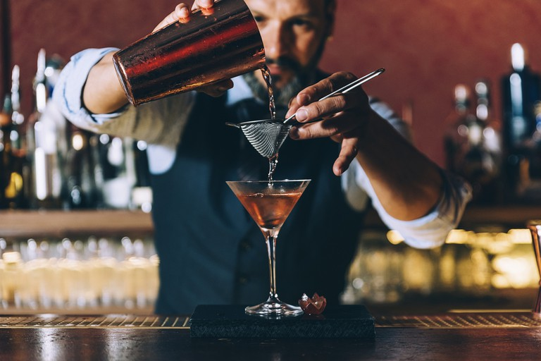 Barman making a cocktail