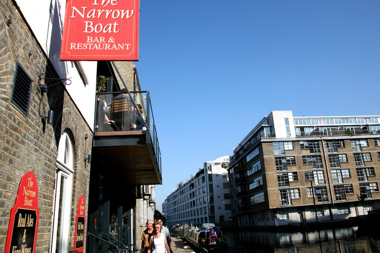 Narrowboat pub/restaurant on banks of Regents Canal, Islington, London.