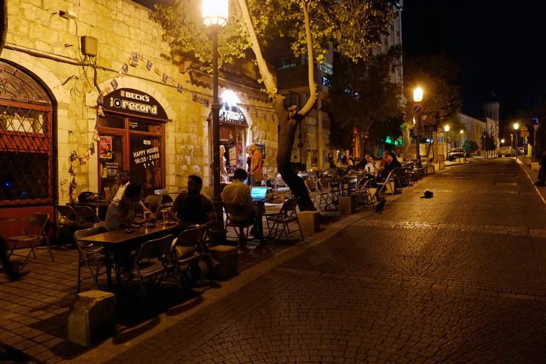 People siting in Hataklit bar located on Qeen Helena or Heleni Hamalka street West Jerusalem Israel