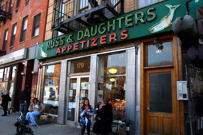 Customers eat their food outside of the family-owned Russ & Daughters, New York City.