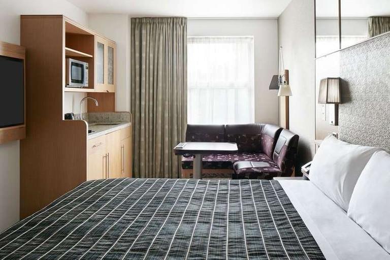 Guest room at Club Quarters Hotel