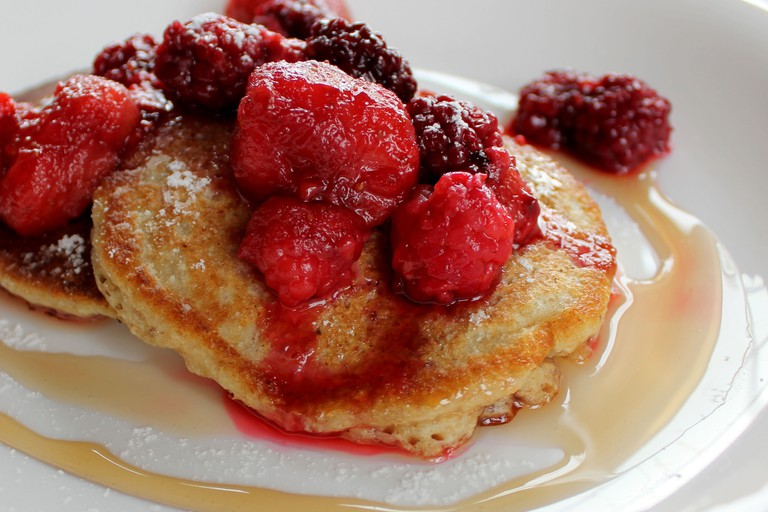 Berry pancakes on a white plate at M on the Bund restaurant, Shanghai, China