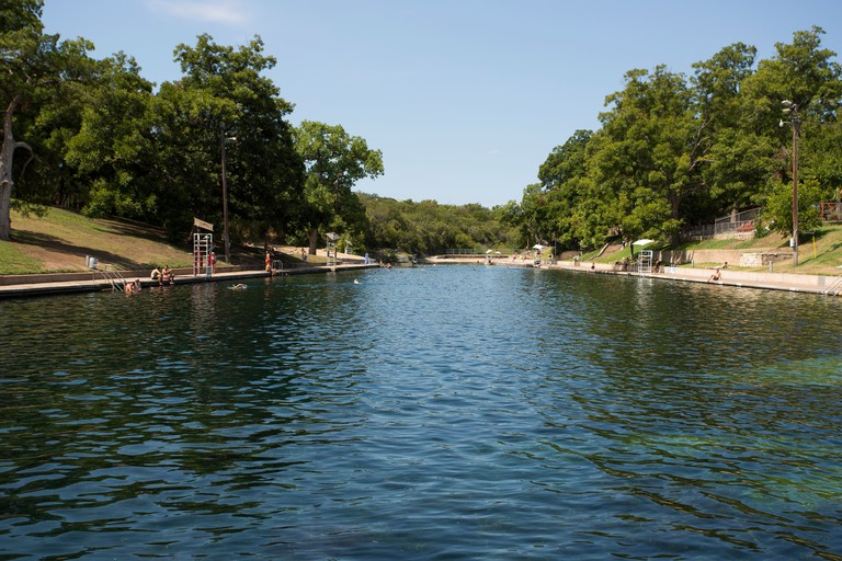 Visitors to Barton Springs Pool can rent kayaks, boats and stand-up paddleboards