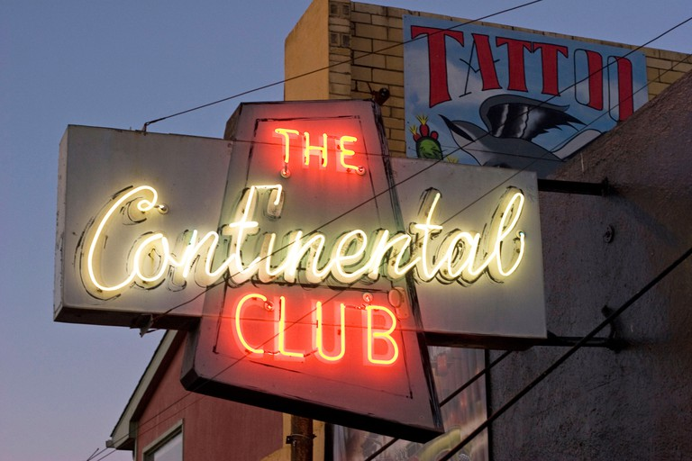 The Continental Club at night with neon sign.