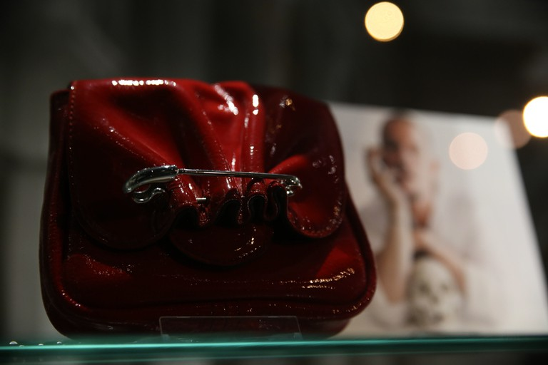 A 2008 Alexander McQueen patent leather shoulder bag with safetypin.