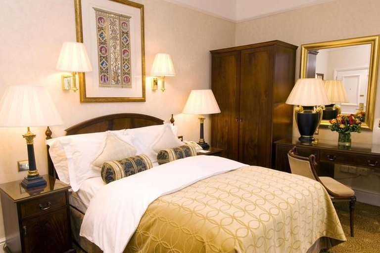 Antique furniture and brocade fabrics give the rooms at The Colonnade Hotel a traditional grandeur