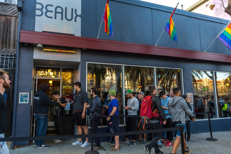 Crowd of Gay Men Waiting online to go in local gay bar, the Beaux, San Francisco, CA, USA.