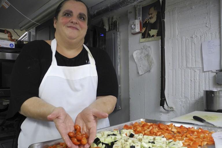 Nonna Margherita prepares Italian food at Enoteca Maria