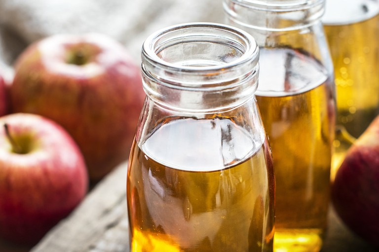Jugs of homemade apple cider