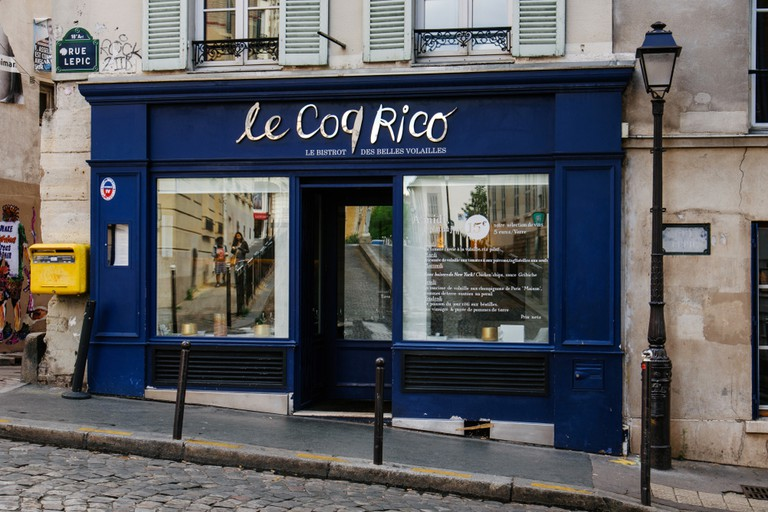 Le Coq Rico restaurant entrance on Rue Lepic.