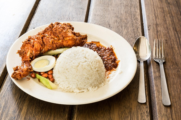 Delicious and aromatic Nasi Lemak with fried chicken, a popular Malaysian delicacy.