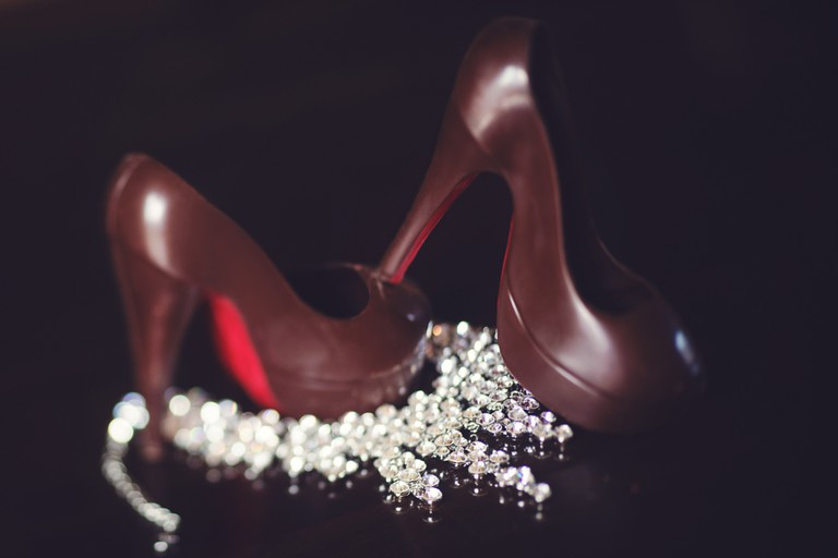 High-heels by the French designer, Christian Louboutin, with shiny, red-lacquered soles that have become his signature.