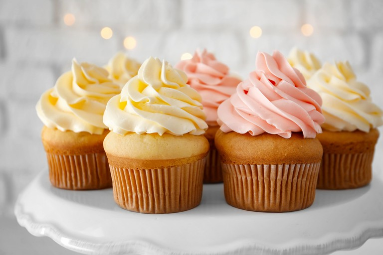 https://www.shutterstock.com/image-photo/tasty-cupcakes-on-stand-778287970