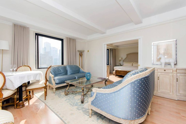 This two-bedroom, two-bathroom apartment is located inside a five-star Midtown hotel
