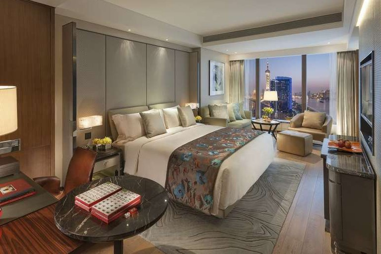 The Mandarin Oriental Pudong soars above the banks of the Huangpu River